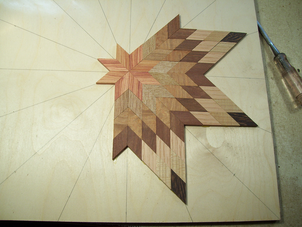 Making a Lazy Susan #10<br /> I continue this process one point at a time on around the star to the last two points.