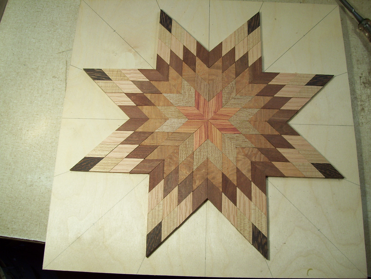 Making a Lazy Susan #16<br /> The last two points I lay out the pieces and glue them on one row at a time, on both points clear out to the tip, in this way completing the star.