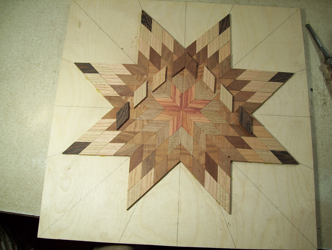 Making a Lazy Susan #15<br /> The last two points I lay out the pieces and glue them on one row at a time, on both points clear out to the tip, in this way completing the star.