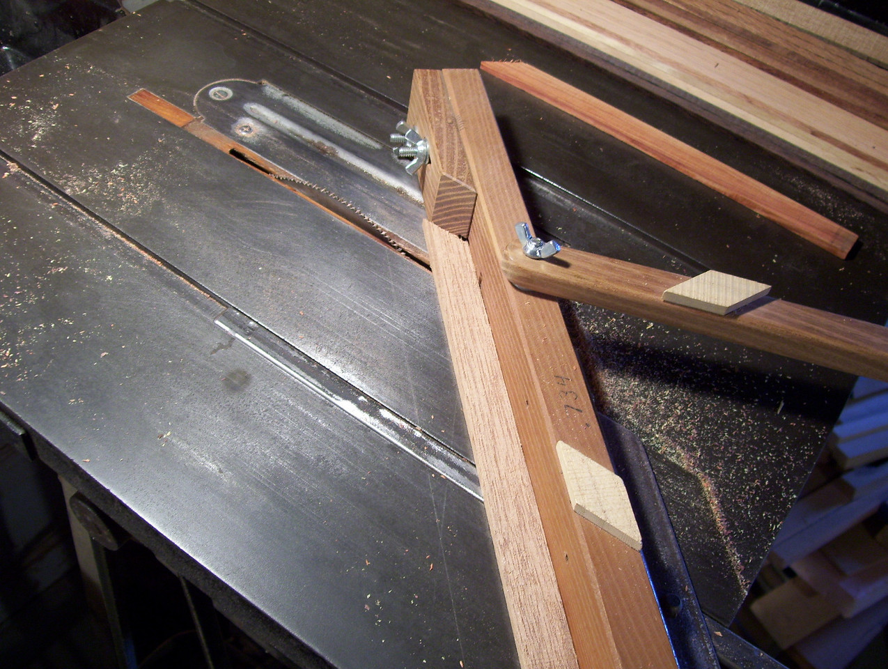 "Making a Lazy Susan #3<br /> This picture shows the jig I made to make the large diamond .734 across each way. I cut them from a strip of wood .200"" thick; I ripped off the edge of a board then narrowed down to .734"" wide. The diamonds have to all be uniform or it will through the whole design off, and multiply any error."
