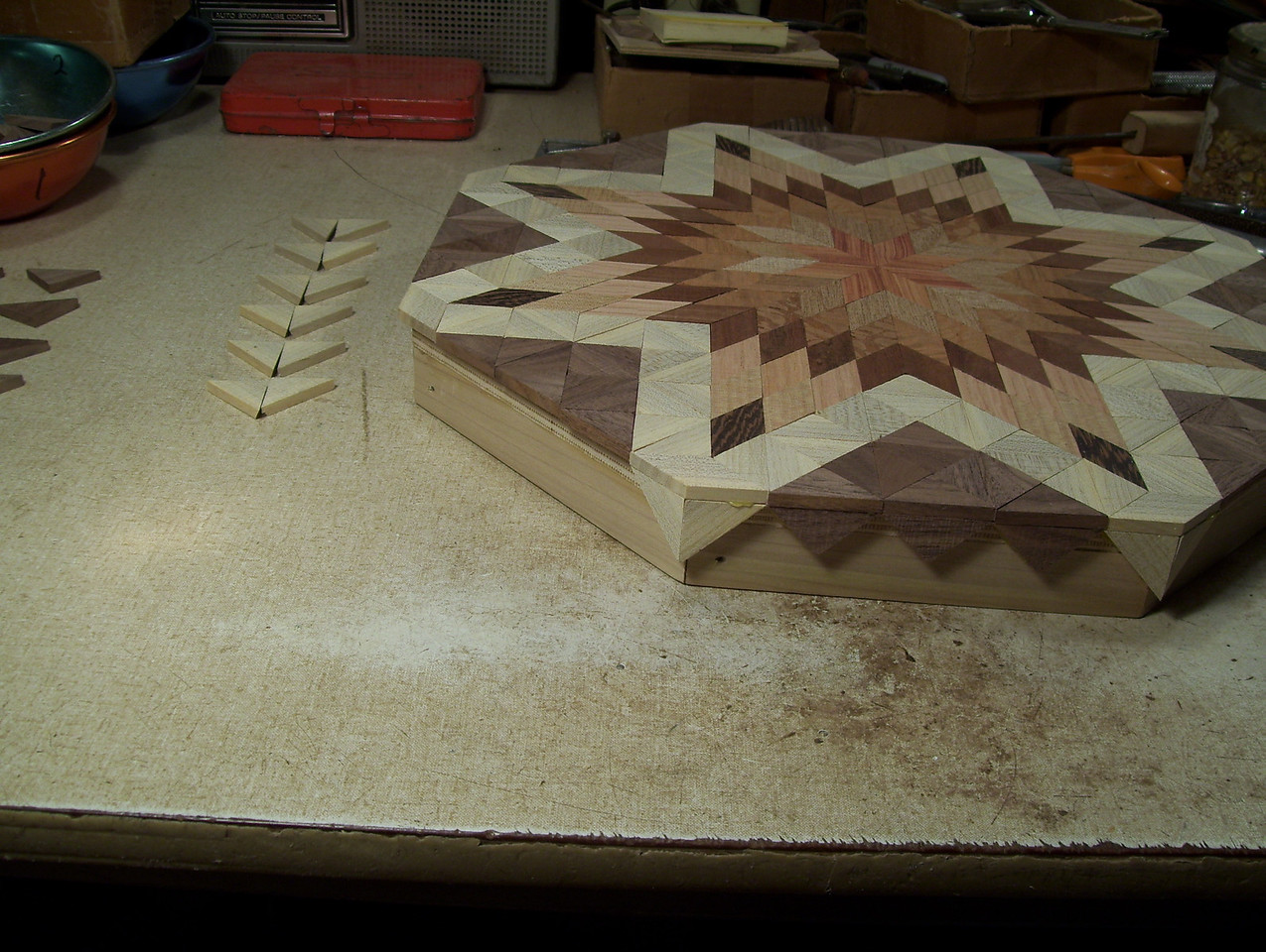 Making a Lazy Susan #42<br /> I then glue the Hackberry pieces that I beveled onto the corner, at the same time gluing them to the overhanging top piece also. I fill in between the corners with Walnut triangles glued to the top pieces and the sides.