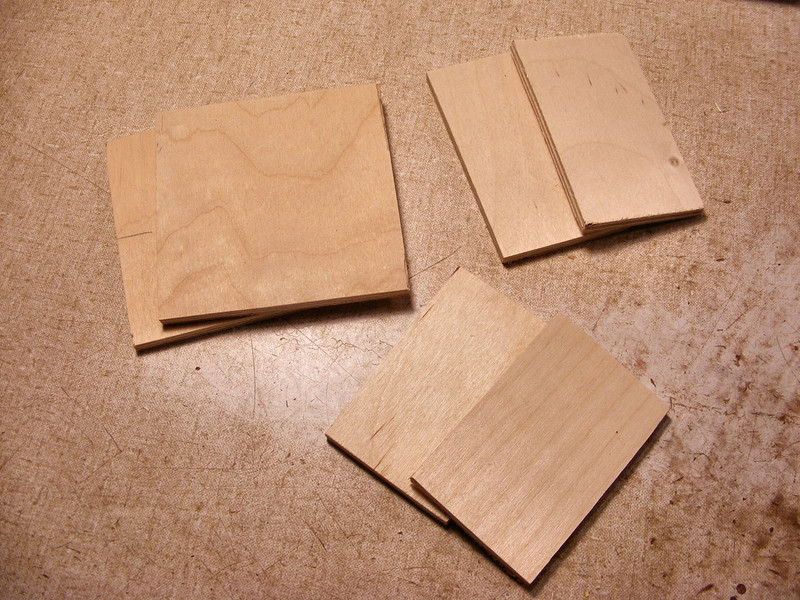 #3 Making a Tiny Sq Box<br /> Knowing the exact size the design will end up I have the base pieces of the box already cut out, four sides and the top and bottom. Before I start gluing the sides of the base onto the top or bottom I make a mark on what will be the front or the back of the top and the bottom and put a number also on what will be the inside. This way I will know what top will go with which bottom when I cut them apart. With the larger boxes they will even be a little different shape because the pieces will go on a little different on each box so on the bigger boxes I cut the side pieces after I know what shape the box will end up. To look at the larger boxes they look the same but they are a little different. The top of one will not fit the bottom of another.