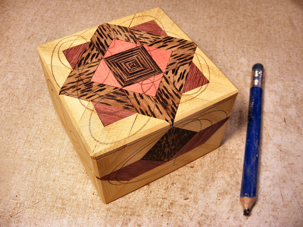 #26 Making a Tiny Sq Box<br /> Now I mark all over it with a pencil, I do this as a final sanding gauge to make sure I get down below the glue I will be spreading all over it.