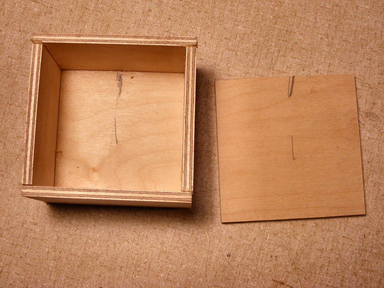 #6 Making a Tiny Sq Box <br />  I use the long side pieces as the front and back of the box, and the short pieces as the ends or sides of the box. The over-lay also adds strength to the box as you can see in picture #32 the over-lay crosses the side joint and then the front and back over-lay crosses the side over-lay. This all adds strength to the simple butt joints that I use.