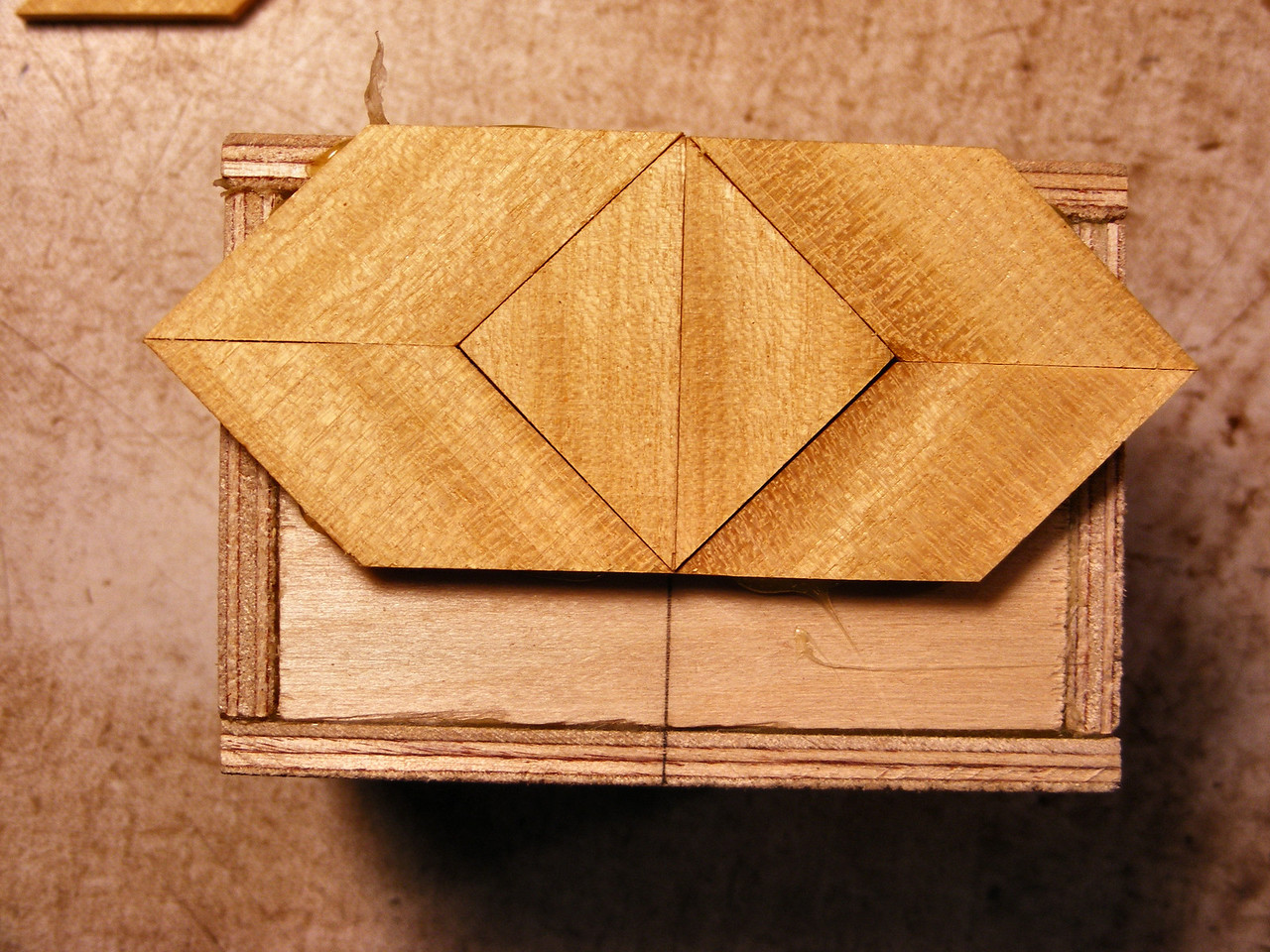 #9 Making a Tiny Sq Box<br /> Next I glue the diamonds on making sure the grain of the wood is going the way I want it to. I will use the grain of the wood to always make a uniform pattern on the box. To me the grain always has a right and wrong way to lay on each piece.