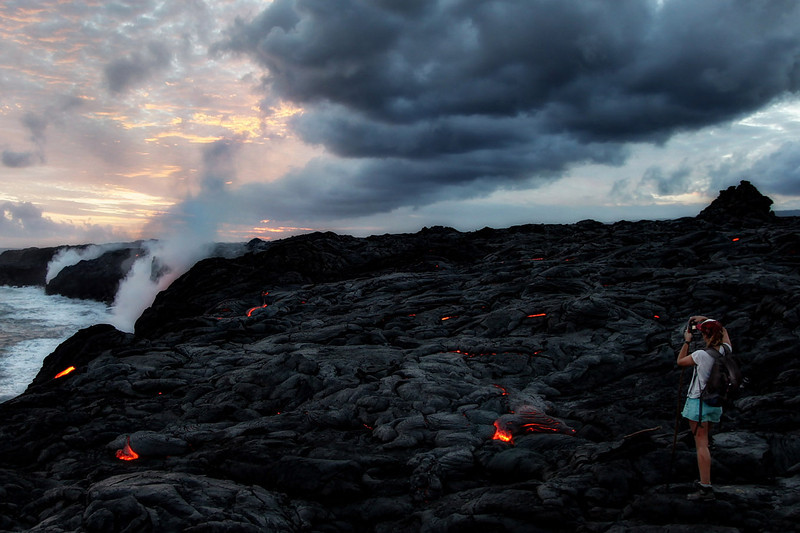 <font size=3><font color=red>Hiking </font size=3></font color=red>  Pu'u 'Ō'ō crater vents lava down the old Royal Gardens Subdivision into a 9 mile area of land between Chain of Craters Road in Hawaii's Volcanoes National Park and Kalapana.  Right now the lava is flowing closest to the Kalapana side, where the hike is less than 3 miles.   This area falls under the jurisdiction of the County Of Hawaii, which currently does not allow hikers without a permit.  However there is a private subdivision in the lava field and several tours leave from there.