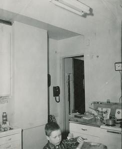Bill ~ 1957 age 5 in kitchen at 20 Village Lane
