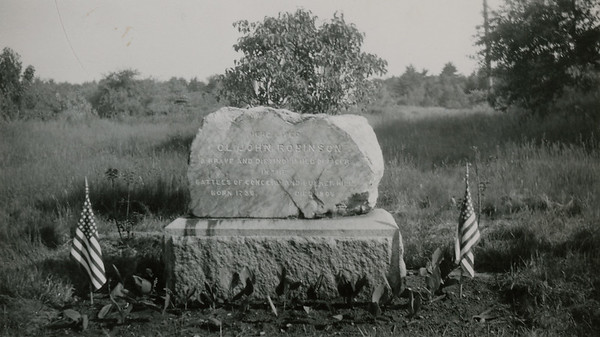 """Gravestone marker: """"Here lived Col. JOhn Robinson. A brave and distinguished officer in the battles of Concord and Bunker Hill. Born 1735. Died 1805."""" Back caption: """"Colonel Robinson marker, Westford [Mass.], cared for by Westford D.A.R."""" 1957 photo."""