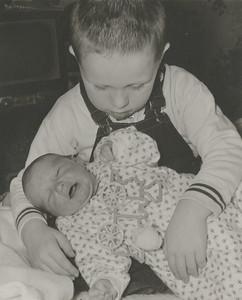 Mark Taif Howard b 1/12/1957 with Bill January 1957