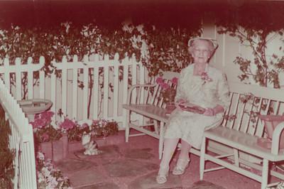 "Massachusetts relative or friend. Back panel caption: ""Taken June 1957, Chelmsford [Mass.] Garden Club. [photo printed week of July 13 1957"""