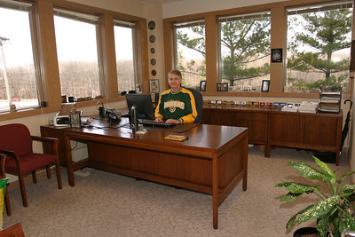 Howard at his desk in his office at Landmark Place before Wipfli moved to their current location.