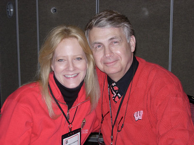 Pamela & Howard attending a Williams, Young & Associates sponsored party in the Nicholas Suite at a UW hockey game.
