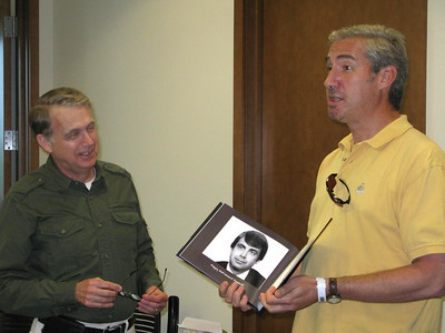 Howard's retirement lunch. Howard was presented with a book of photos from his 35 years with Williams, Young & Associates and WIpfli.  The black and white photo of Howard is circa mid 1980s.