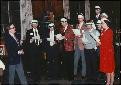 Early 1980s, WY&A partners singing at a firm party.