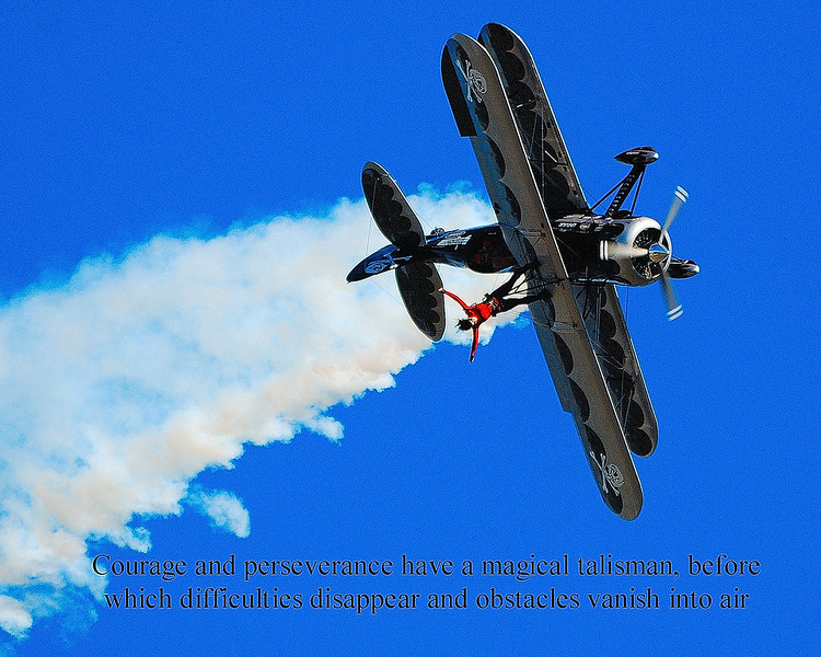 Amanda Franklin was an incredible air show stunt woman who performed amazing feats in her short life. I was fortunate to capture one of them at the Monroe Warriors and Warbirds Airshow<br /> The quote is by John Quincy Adams