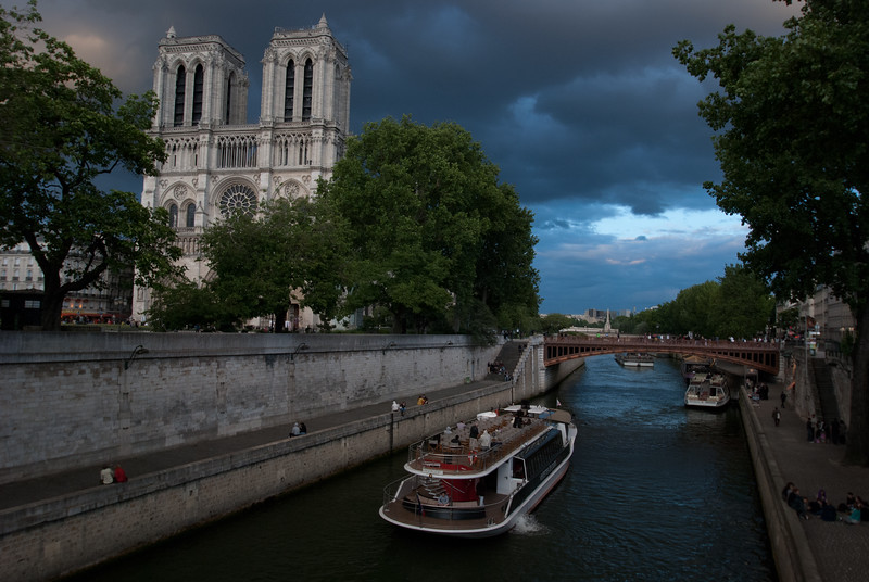 Boat on Seine passing Notre Dame