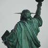Broad shoulders and strong back of Liberty
