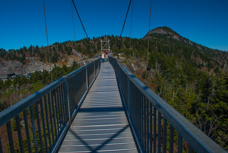 I remember crossing this bridge in the 80's when it was wooden and ropes, and really swinging. Today it is secured with cables, and still swings a little when the winds pick up.
