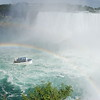 Maid of the Mist heading to the Horseshoe Falls, guided by a double rainbow