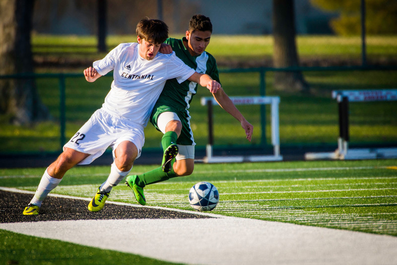 Dakota Mulder (22), Senior, Forward, battles for the ball when Ankeny Centennial High School Boys Varsity Soccer Team played Hoover High School