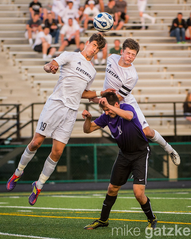 2015.05.21 Jake Pinegar (19), Forward, and Garrett Culligan (10), Mid-Fielder, both leap to head the ball back into play during the 1st half of the Ankeny Centennial vs Johnston soccer game.