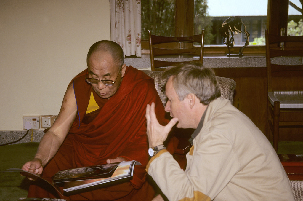 "Bill Chapman discussing plans for his  book ""The Face of Tibet"" with His Holiness the Dalai Lama during a private audience in Dharamsala, India.  Dharamsala is the seat of the Tibetan Goverment in exile.  Over the past two decades Bill has made more than a dozen trips to Tibet working as a freelance photographer in addition to leading photography workshop tours."