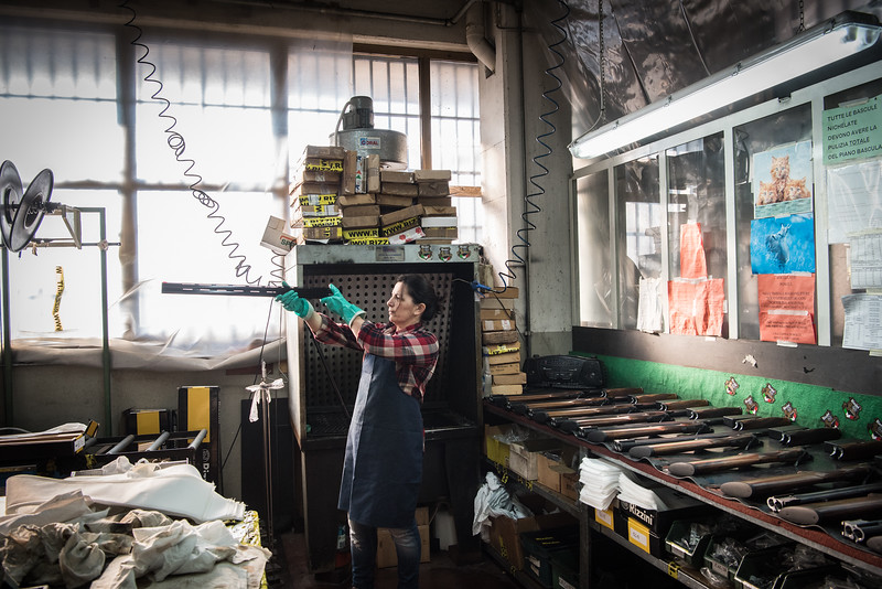 February, 2018 – Val Trompia, Italy. A worker during the final check of gun at a gun factory.