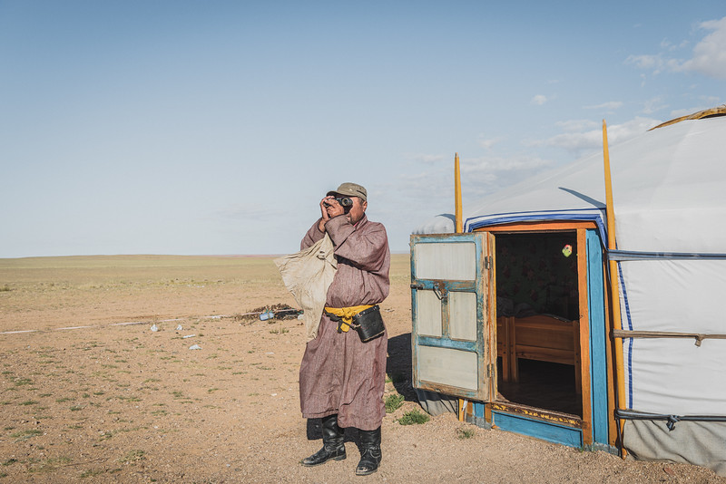Mongolia, Gobi, 2019. Nergui keeps a close eye on his sheep and goats. Herders move locations throughout the year to the most appropriate spots, to cope with dramatic changes in weather conditions and food availability. Despite the daily challenges he has to face, he refuses to give up on this way of life.