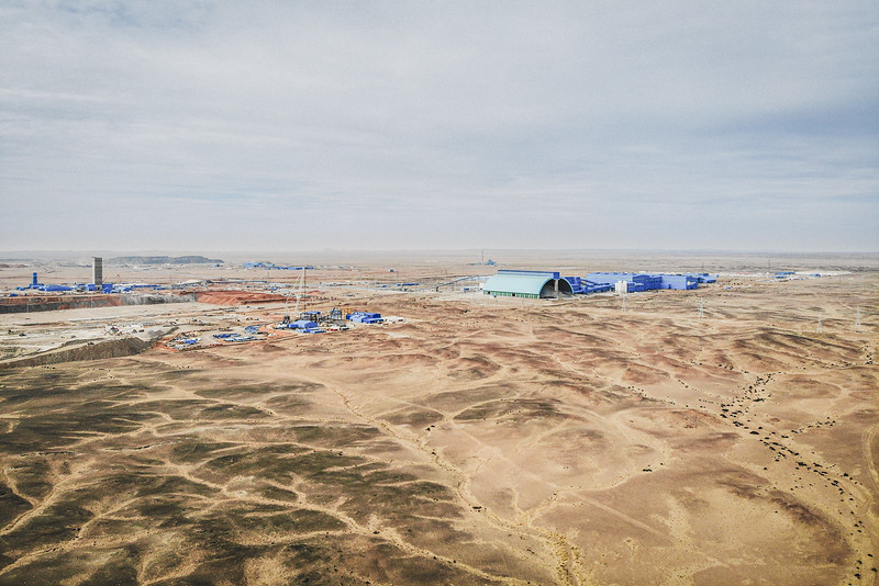 Mongolia, Oyu Tolgoi, 2019. The Oyu Tolgoi mine. Oyu Tolgoi is one of the largest known copper and gold deposits in the world. The construction of the Oyu Tolgoi mine was led by Rio Tinto Group, a multinational corporation, and the Mongolian government. The construction began in 2011, displacing the herdsmen, who claim they were reduced to collecting waste from the mine just to make a living.