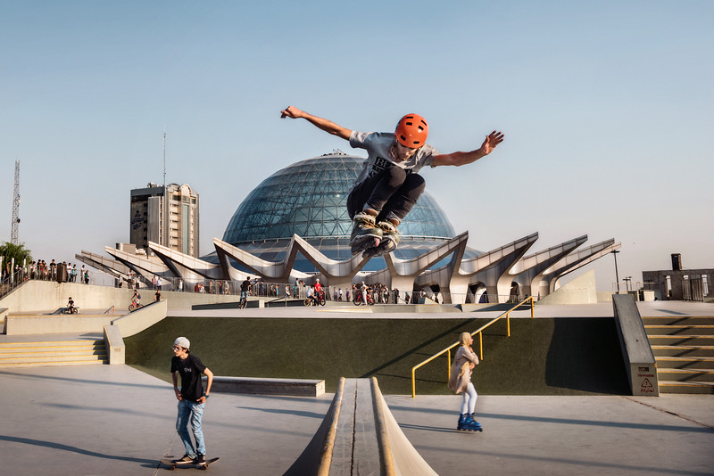 """August 11, 2017 – Teheran, Iran. """"Âbo atash"""" (water and fire) is the largest skatepark in the Middle East. Built in Tehran by a German company three years ago, many young people come to train on skateboard, skating or biking. The rise of a community of young skaters in Tehran is one of the strong signs that the country is really changing in the right direction. In a country that sentences the Western way of life, more and more young people are engulfing the asphalt on their skateboards, like Americans and Europeans. More than a hobby, a way to affirm their freedom. Ten years ago, there were only thirty skaters in Iran, today there are almost 3,000 including a number of girls who make skateboarding one of the few mixed sports in Iran. The young people fought for this, and remember with satisfaction when their first tables were locked at customs because they came from the United States. © Simone Tramonte"""