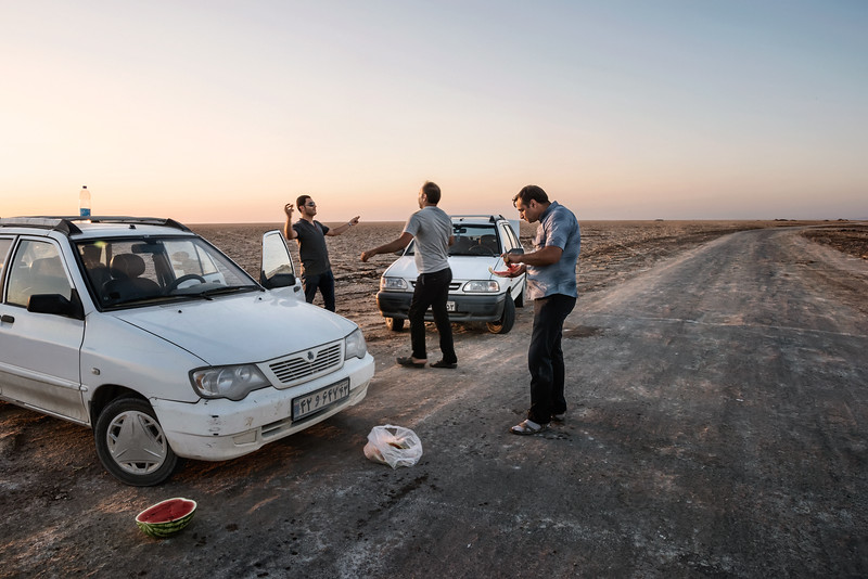 """August 25, 2017 – Kashan, Iran. (Namak Salt lake). Dancing in public in Iran is illegal. In spite of repression, however, Iranians do not give up and continue to dance. Young Kashan boys dancing far from prying eyes at the edge of the salty desert. """"Our country is like two parallel worlds. It's the one you see outside, and then is this world behind closed doors. In here we are free!"""" relates one of this young boys. © Simone Tramonte"""