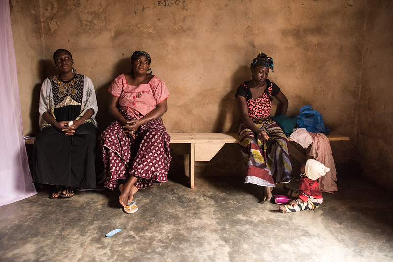 """Bobo Dioulasso, Burkina Faso. The waiting room of Madame Pharmacies, a gynecologist that treats patients exclusively with medicinal herbs. In this context of absolute poverty and misinformation, medicinal plants, traditional treatments and """"healers"""" are the main, and sometimes the only, source of health care."""