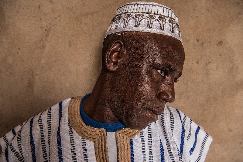 Manga, Burkina Faso. The scars on his face are the traditional scarifications of the mosi people.