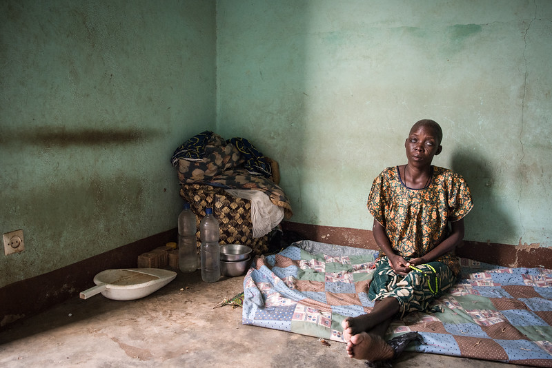 """Koupela, Burkina Faso. In West Africa where the boundary between medicine and mysticism is subtle, many women are still accused of being witches, persecuted, burned alive, or """"socially killed"""". Cecile Sawadogo, is a woman accused of witchcraft. She lost her sight in a fire during her hunting, and found shelter in the reception center of Saint Lazare in Koupela, where she was abandoned by the community. She spends her time sitting on the ground of her room. Her story is primitive and tragic, a ruthless ritual to which none of these women accused of witchcraft could escape."""