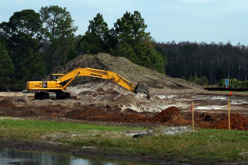 HCC crews excavate Pond 23.
