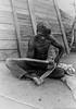 Tommy / Kampuwarntikura carving a boomerang, 1969