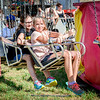 From left, Adrien Lopez, 12, and Sammy Sylvester, 12, both of Hudson get ready to ride the swings at the Hudson Old Home Days. SUN/Caley McGuane
