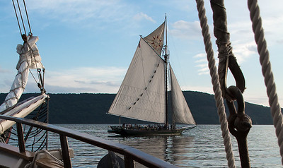 The Hudson River Sloop Clearwater from the bow of the Mystic Whaler near Croton on Hudson.