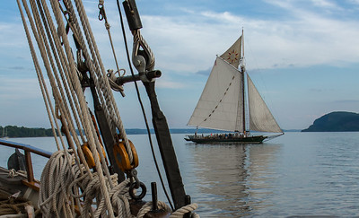 Hudson River Sloop Clearwater taken from the Mystic Whaler with the Hudson Highlands in the backgrounds.