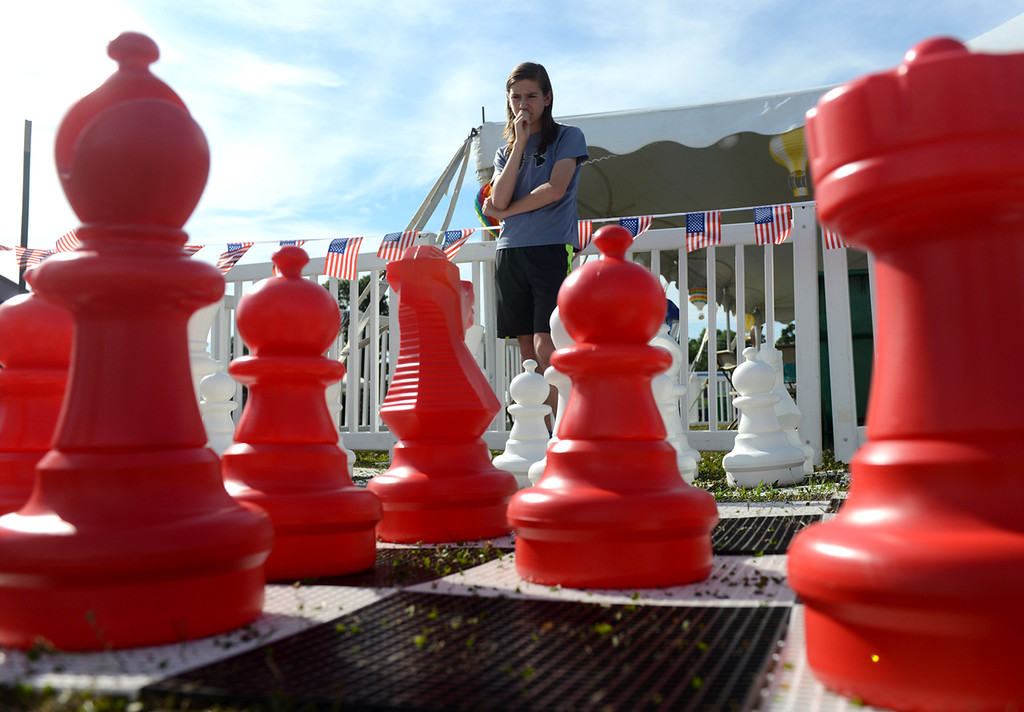 . Tania Barricklo-Daily Freeman    Jason Swart, 14, son of Holly and Wayne of Clermont contemplates his next move while playing a giant game of chess at the opening day of the  Hudson Valley Balloon Festival  Friday at the Dutchess County Fairgrounds in Rhinebeck, N.Y.
