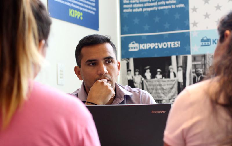 Lynn, Ma. 9-18-17. Hugo Carvajal working with parents at KIPP Academy.