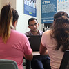 Lynn, Ma. 9-18-17. Hugo Carvajal working with parents at KIPP Academy.