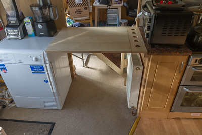 Clever solution: folding table in crammed caravan kitchen