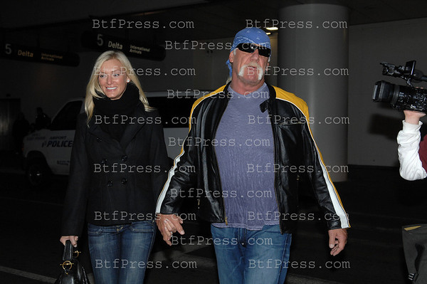 Exclusive-- Hulk Hogan arriving at LAX airport in Los Angeles with his new girlfriend.