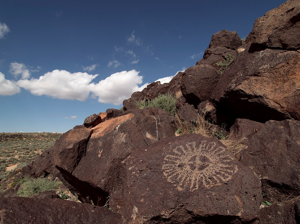 Petroglyph.  400-700 years ago, indians pecked away the outside of basalt boulders to create rock drawings that remain today.