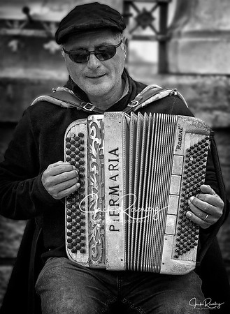 """Blind Accordionist"""