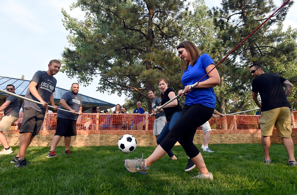 . Amanda May, with team HYPE, kicks the ball towards the goal while playing a game of human foosball during the Broomfield Chamber of Commerce\'s annual member appreciation picnic on Thursday in Broomfield. For more photos of the human foosball game go to dailycamera.com Jeremy Papasso/ Staff Photographer 08/02/2018