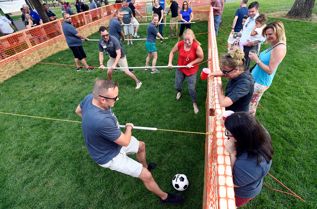 . Goalkeeper Brandon Laws, with team Elevations Credit Union, kicks the ball downfield while playing a human foosball game during the Broomfield Chamber of Commerce\'s annual member appreciation picnic on Thursday in Broomfield. For more photos of the human foosball game go to dailycamera.com Jeremy Papasso/ Staff Photographer 08/02/2018