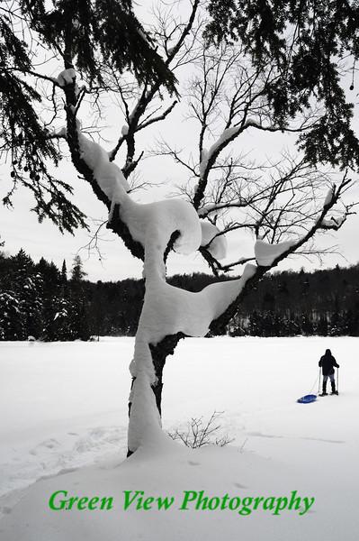Snow Shoeing across the frozen lake
