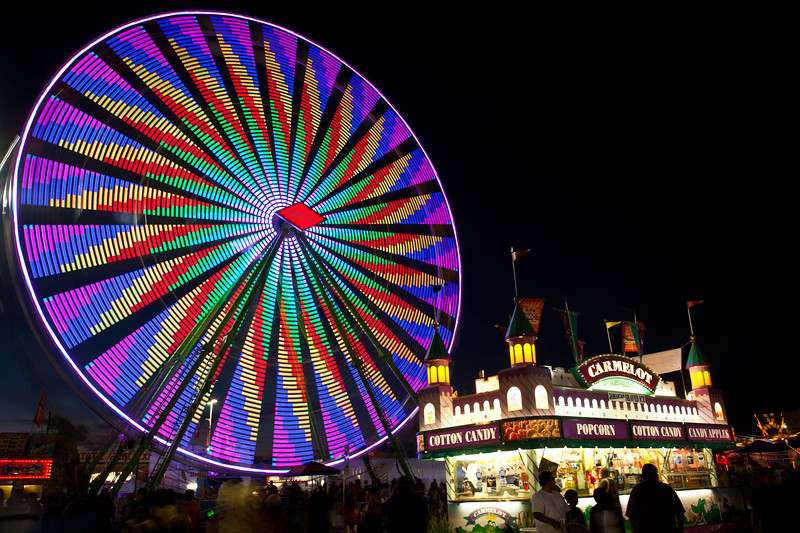 One of the ferris wheels at the 2011 Arizona State Fair.  The wheel changed colors and patterns every few seconds.
